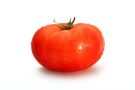 Tomatoes. One fresh delicious whole tomato isolated on a white background.