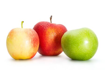 Delicious appetizing beautiful fresh green and two red apples isolated on a white background. Stock fotó