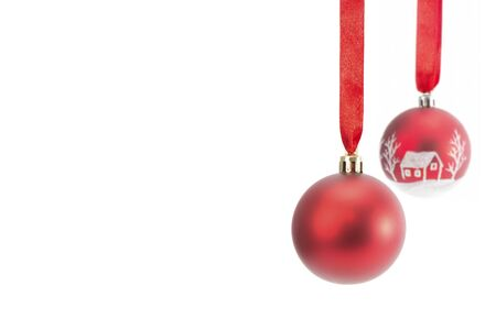 Two red Christmas balls hanging on ribbon Isolated on white background