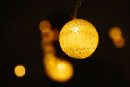 Christmas lights on dark background. Ball shaped.