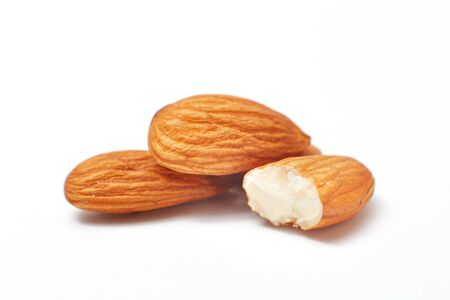 Processed almonds isolated on white background