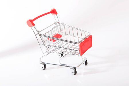 Small shopping cart on a white background Zdjęcie Seryjne