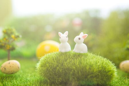 Spring meadow with a rabbit and easter egg. Fairy tale Stock Photo