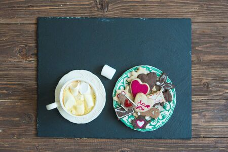 Cup of cocoa with marshmallows and cookies in the shape of hearts, Valentines Day celebration top view copy space