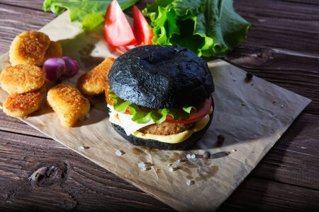 Delicious fast food. Fresh tasty burger on wood table