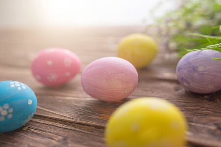 Easter eggs on a old wooden surface