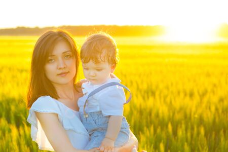 Beautiful woman with a baby in field