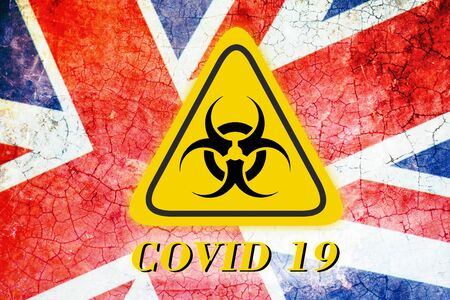 Quarantine sign COVID 19 on the background of the flag of United Kingdom . Virus Pandemic Protection Concept Foto de archivo