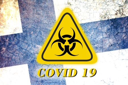 Quarantine sign COVID 19 on the background of the flag of Finland . Virus Pandemic Protection Concept Foto de archivo