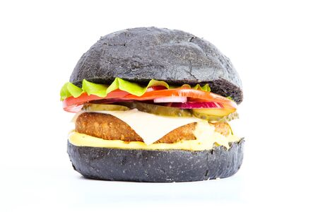 Delicious fast food. Black burger with beef meat cheese lettuce onion, tomato isolated on a white Stockfoto