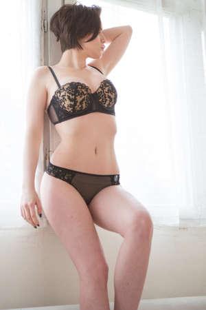 Lovely beautiful girl in elegant underwear in the room Foto de archivo