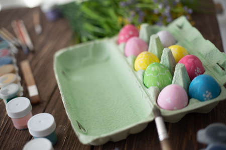 Table with paint and brush for painting easter eggs