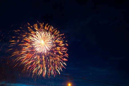 Fireworks on the background of the dark night sky. 4th July - American Independence Day