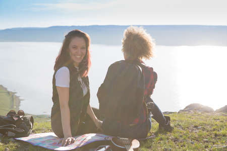 Two beautiful girls are traveling in the mountains