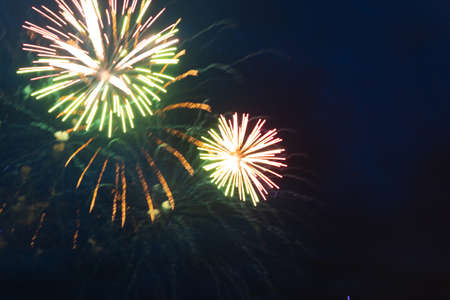 Brightly colorful fireworks and salute of various colors in the night sky. Independence Day, 4th of July, Fourth of July or New Year.