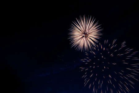 Fireworks on the background of the cloudy night sky. 4th of July - American Independence Day USA 版權商用圖片
