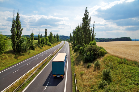truck crops: The rural landscape with a highway leading poplar alley, truck driving down the highway, view from above