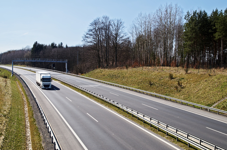 haulage: expressway around the woods in early spring.