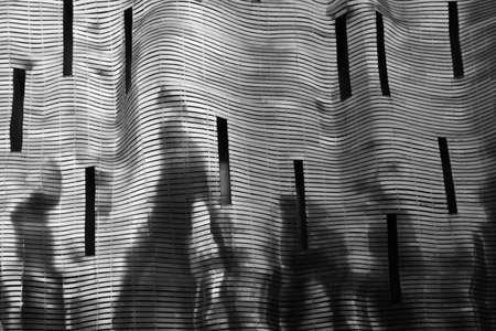 fluidity: Floating silver building facade
