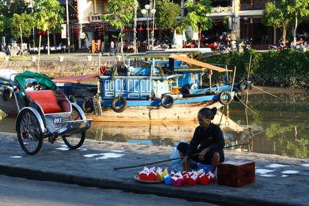 laterns: vietnamese elderly womon selling floating laterns for full moon festival in Hoi An, Vietnam, 15.06.2011