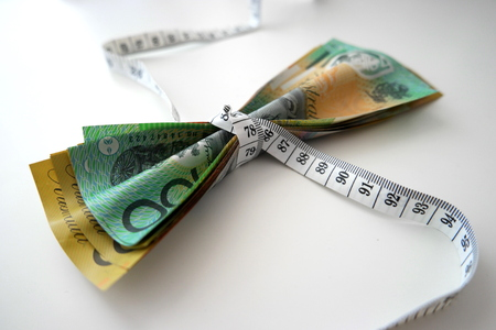 Tape measure tightly wrap Australian banknotes