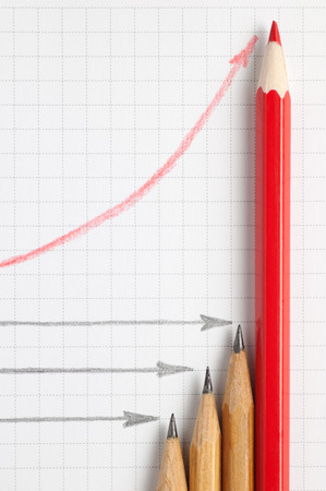 one sheet: Three grey pencils and red one with diagram of three horizontal grey lines and one rising red curve on paper sheet top view Stock Photo