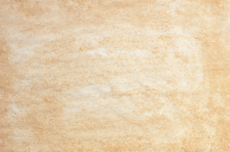 yellowed: Abstract background stained yellowed paper sheet surface