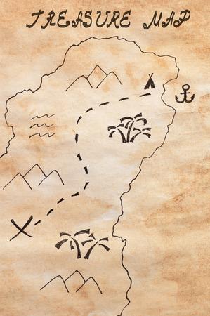 carte tr�sor: Gros plan de la feuille de papier jauni teint� avec une partie de la main sch�matique dessin�e carte au tr�sor et titre manuscrit Treasure Map