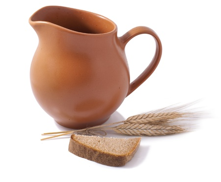 Jug with bread and wheat  Stock Photo - 22013593
