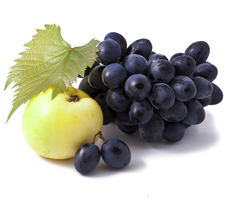 apple and grape on the white Stock Photo - 23072964