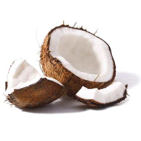 aceite de coco: Los pedazos de coco aislados en un fondo blanco Foto de archivo