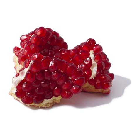 pieces of pomegranate isolated on the white Stock Photo - 23075530
