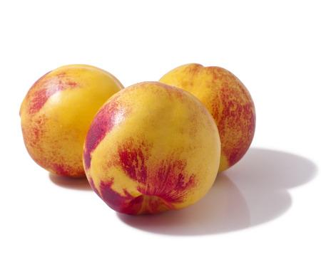 Three whole peaches isolated on white background  Stock Photo - 23075531