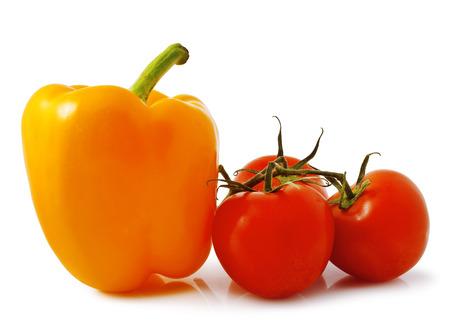 fresh tomato and orange bell pepper on white background