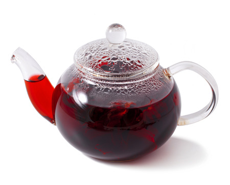 brewed tea in a teapot. Isolated on a white background  Stock Photo