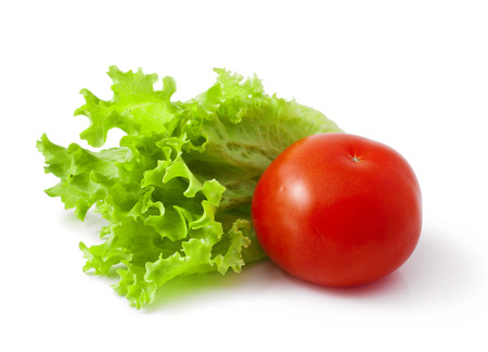 fresh tomatoes with green lettuce isolated on white background Stock Photo