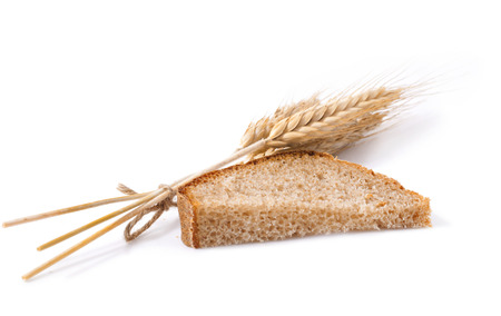 bread and wheat on a white background