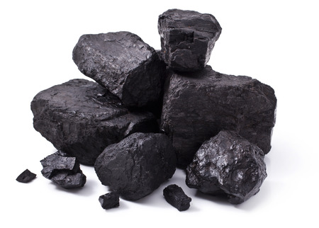coal fire: pile black coal isolated on white background
