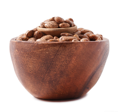 pinto beans on wood cup isolated on a white background