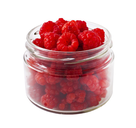 Ripe Raspberries in a bank on a white background