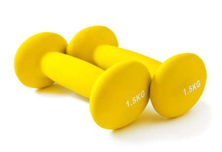 Fitness yellow dumbbells on a white background Stock Photo