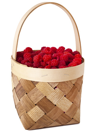 raspberries in the wooden basket isolated on white background Stock Photo