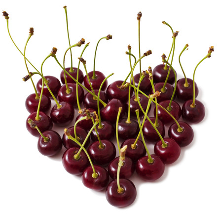 Ripe cherry in shape of heart on a white background