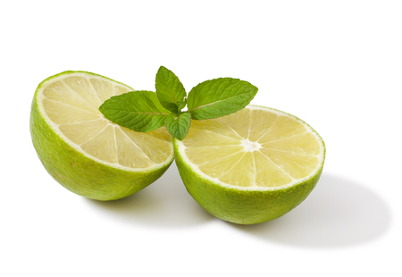 Fresh lime with mint isolated on a white background