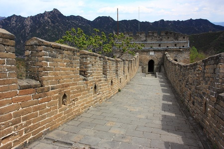 feats: The great wall of China, with a beautiful mountain.