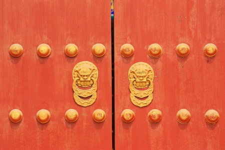 Chinese red door with two lionsdragons head photo