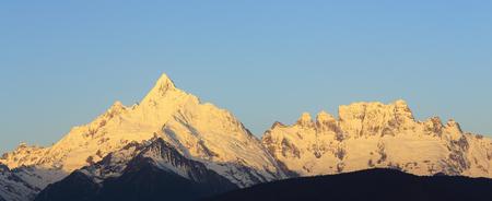 sunrise of snow mountain,China,Tibet photo