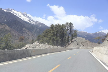 snow mountain with road in china photo