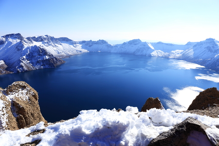 crater lake with snow in winter photo