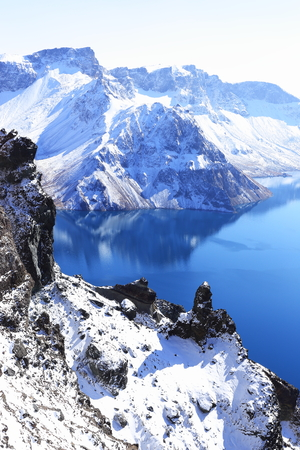 crater lake with snow in winter Stock Photo